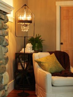 A thrift-store birdcage is paired with an old chandelier to create a unique floor lamp. Design by Joanne Palmisano