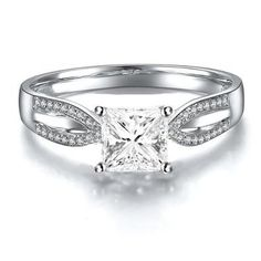 Princess Cut White Diamond Engagement Ring - A Princess deserves to be treated like one and the best way a man can do it is by giving her this adorable Princess Cut White Diamond Engagement Ring in 14k White Gold in a Designer setting featuring a White Princess cut center stone with White Round gemstones on the open shoulder shank. The Princess Cut White Diamond Engagement Ring has a gem weight of 1.17 carats. The diamonds are 100% natural. #unusualengagementrings