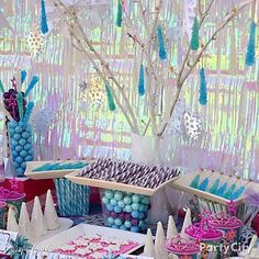 """This snowy & sweet candy buffet by Crissy's Crafts is *too-cool* with rock candy """"icicles"""" and snowflakes – a winter wonderland for her Frozen party."""