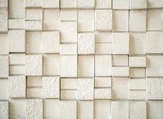 Create a realistic stone wall using Styrofoam pieces.