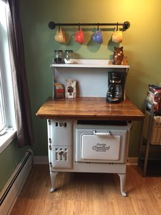 I just made this from an antique stove that we picked up. It was in great shape but missing a few parts. Needless to say I'm obsessed with my new coffee bar!