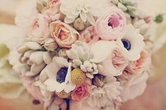 What are these white with purple ones? Soft pastel roses, anemones and ranunculus - wedding bouquet