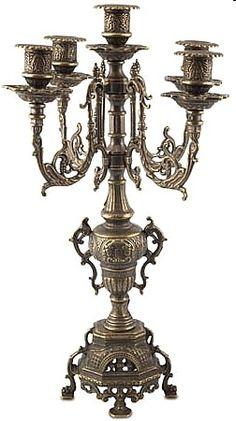 ... designed European candelabra highlighting medieval designs. Brass