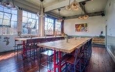 Offsite and meeting space with hardwood floors, bar stools, high wooden tables, industrial light fixtures and sunny, natural light. Industrial Windows, Industrial Light Fixtures, Industrial Chic, Wooden Table And Chairs, Lunch Room, First Home, Second Floor, Decor Styles, Small Spaces