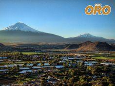 """LAS MEJORES RUTAS DE AUTOBSES. La ciudad de Atlixco está ubicada en la parte centro del estado de Puebla, y es conocida como """"La ciudad de las flores"""", además de sus diversas tradiciones, atractivos naturales y sobre todo por la hermosa panorámica de los volcanes Iztaccíhuatl y Popocatépetl. En Autobuses Oro le ofrecemos placenteros trayectos, viajando en los autobuses mejor equipados. #autobusesaatlixco"""