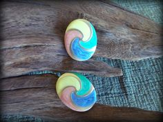 Vintage gold tone swirl colored clip on earrings Apricot, yellow, light green, and light blue enamel swirls and gold tone metal earrings by STUFFEZES on Etsy