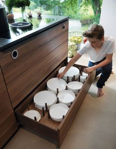 Kitchen Drawer Organization - Design Your Drawers So Everything Has A Place // Cylindrical wood dowels create individual sections for the plates to sit in to maximize storage space and to protect the dishes.