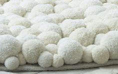 Pompons in Modern Interior Design, Chairs, Poufs and Carpets from Bommel MYK