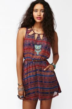 Super cute chiffon dress featuring cutout detailing and a multicolor southwest print. Front pockets, stretch panel at waist. Partially lined. Perfect paired with suede boots and a crossbody bag!