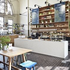 Situated in the Old Market Hall in Helsinki, Finland, is a cafe-restaurant that showcases the mixed-material trend to stunning effect.