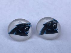 New, NFL Carolina Panthers Button Pierced Earrings. Amazing gift for a Carolina Panthers Fan. 14mm. View pictures for details and measurements. We offer combined shipping.