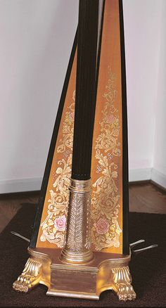 Soundboard and base of a J.F. Browne double action Grecian harp, with custom soundboard art, restored by H. Bryan & Co.