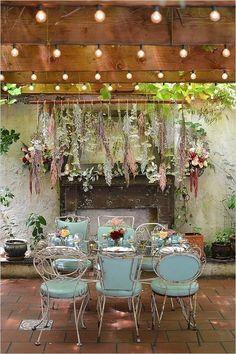 """Hanging floral """"chandelier"""" for an indoor garden wedding"""