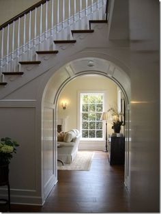 When a staircase cuts through another space, use the opportunity for design impact, such as this paneled archway.