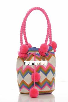 We are obsessed with wayuu mochila pom-poms this season!