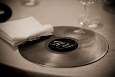 DIY Wedding Chargers: Old records spray painted a bronze gold (to match the back of the chairs) with a custom sticker in the center. We wrote a thank you on the back of each so they were also used as the favors. Wedding Dinner, Wedding Table, Diy Wedding, Wedding Reception, Dream Wedding, Wedding Ideas, Moms 50th Birthday, 70th Birthday Parties, Deco Disco