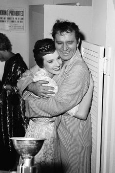 Richard Burton happily embraces his co-star Julie Andrews