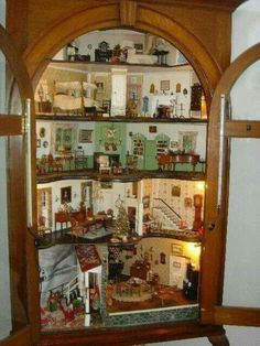 Convert an old curio cabinet into a dollhouse.