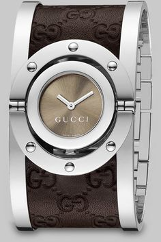 Brown Stainless Steel & Leather Cuff Watch / Gucci. And for Skin Care Visit: http://www.bareindulgence.net