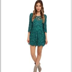 """Free People Embellished Songbird Romper This romper from Free People is stunning! It's a gorgeous emerald color, has beautiful embellishments, lace scalloped edges, and a beautiful cut-out back. Perfect alternative to a dress, and would look so great for a night out! Size 4. Runs true to size. Body is lined. All measurements taken lying flat: Bust- 17"""", waist- 14"""", hips- 19"""", inseam-3"""". Has tags and extra bag with beads! Free People Pants Jumpsuits & Rompers"""