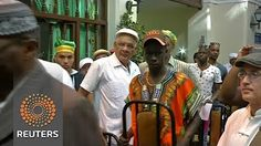 2:45  Cuba's Santeria priests forecast prosperity in New