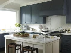 blue grey Benjamin Moore Tempation with island in Basic Beige, by Glidden, countertops are calcutta oro