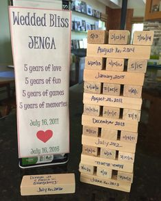 Celebrate your fifth anniversary with the traditional gift of wood. A Jenga game with five years of memories written on each wooden game piece. #weddedbliss #jenga #woodenanniversarygift #fifthanniversary #handmade #madewithlove #thoughtful