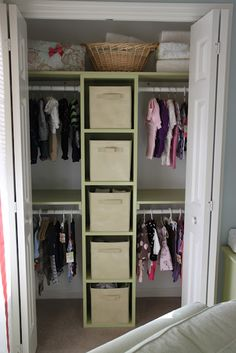 This organizer would be nice the closet in the boys' room.  One boy on each side of the storage divider.  Possibly add shoe organizer on the floor.