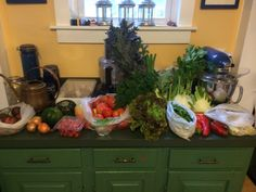 Week 9 - September 30, 2014: Peacock broccoli, regular broccoli, green celery, fennel, lovelock lettuce, arugula, purple viking potatoes, leeks, gold of macau snap beans, buttercup squash (round hat like), acorn squash, grape tomatoes, slicing tomatoes, tomatillo, curly parsley, yellow onions and sweet peppers.