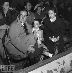 Gene with his wife Betsy Blair and their daughter Kerry at an Ice Follies performance, 1955.