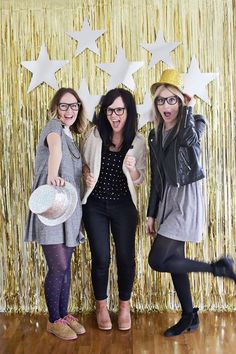Not only is this DIY backdrop easy to make, but also it's easy on the bank. Head to your nearest party supply store, grab some metallic party streamers–you'll probably need two or three packages to layer and hang. Give the backdrop an extra fun edge with cut outs of your favourite shapes, from stars to hearts, and tape these against the streamers.