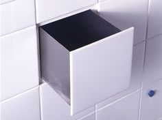 Oh wow how clever and awesome is that.. Be cool to have it bigger to store shampoos/soaps in to keep it out of view!