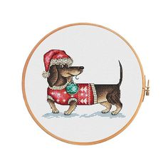 Christmas dachshund with christmas tree toy - cross stitch pattern. Floss: DMC Canvas: Aida 14 White. Design Area: 94x77 stitches or 6,7 x 5,5 inch or 17,1 x 14 sm Canvas: Aida 16 White. Design Area: 94x77 stitches or 5,9 x 4,8 inch or 14,9 x 12,2 sm Canvas: Aida 18 White. Design Area: 94x77 stitches or 5,2 x 4,3 inch or 13,3 x 10,9 sm Number of colors: 21  This PDF pattern Included: - the key to the deciphering of colors DMC and symbols, the number of strands, number of strands DMC, - color…