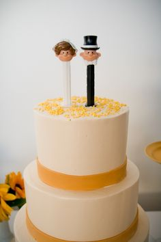 we had the pez bride and groom for our wedding cake topper!  we had to break ours out of a snow globe, though.  they were a perfect size! :D