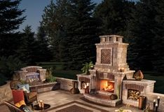 Umbriano patio with water feature and fireplace