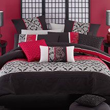 Classic black is beautifully enhanced with panels of ornate silver print and contrasting red panels with intricate black and silver embroidery. Pleating detail and red and pewter ribbon trim provide extra touches to this elegant and tasteful design.