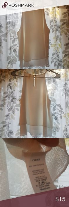 White stylish tank. NWOT. Never worn. White two layer at bottom, thin straps 100% polyester. Never Worn. From Petal. Tops