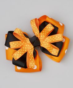 Add a little festive flair to hair with this brilliant bow. Boasting a triple layer of pattern-packed ribbons and a trusty alligator clip, it'll dress tresses without any pinch or pull.