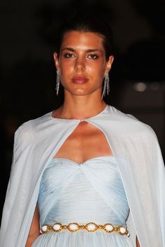 After the ceremony installing the new princess of Monaco, the stunning brunette, who was elegantly dressed as always in Giambattista Valli couture, helped host 450 VIPs in lavish style at the Opera House.  And fittingly for someone whose discretion and beauty recall her famous grandmother, she was wearing a colour dubbed 'Princess Grace blue' by the fashion house