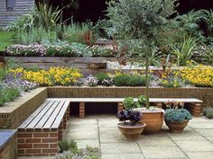 Plantings in garden beds. Lawn & Garden:Delightful Terraced Flower Garden Design With L Shape Garden Bench Also Wooden Garden Edging Plus Rustic Potted Plants Inspiring Terraced Garden Ideas for Small Space Solutions