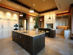 Extravagant island dream home. I love how big this kitchen is