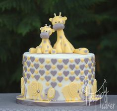 """Elephants and giraffes - Yellow and gray scheme elephant and giraffe baby shower. 8"""" coconut cake filled with coconut buttercream."""