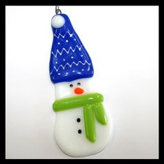 Meet POLAR, the fused-glass snowman ornament with the pretty dark blue stocking…