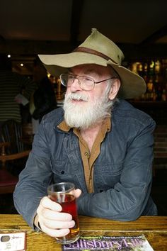 Terry Pratchett enjoys a half pint of Badger Ale in his local pub The Queen's…