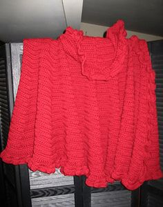 This pattern was adapted from a Lion Brand Night and Day Poncho and a Caron Brand Ruffle Scarf with Bliss. I combined parts of both patterns and created this one which is very different and very popular.
