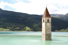 The Submerged Church of Curon Venosta, (Curon Venosta, Italy)The steeple of the church juts out in Lake Resia, the body of water that was artificially made after the town was abandoned.