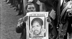 """Biko and Solidarity  [Click on this image to find a short video and analysis of the conditions of apartheid in South Africa and why that system of oppression is comparable to Jim Crow segregation in the U.S.]  """"Merely by describing yourself as black you have started on a road toward emancipation, you have committed yourself to fight against all forces that seek to use your blackness as a stamp that marks you out as a subservient being.""""   ~ Steve Biko  Photo credit: STF / AFP / Getty Images"""