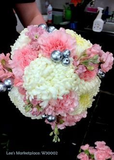 One of the beautiful custom wedding bouquets designed by Lee's Corner Floral. Learn more or order yours today at leesmarketplacefloral.com