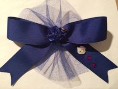 Blue Hair bow with Hello Kitty on it by HelgasHairBowDesigns