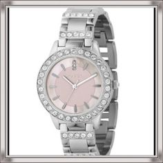 Fossil pink & mother-of-pearl watch with BLING!  Breathtaking Fossil ES2189 STAINLESS STEEL BRACELET PINK MOTHER-OF-PEARL GLITZ ANALOG DIAL WATCH!  Pre-loved but still many more years of love to give!  All it needs is a battery and you're ready to go!  All minor wear and tear scratches are underneath so they go undetectable. Looks like it is made for a princess! Fossil Accessories Watches